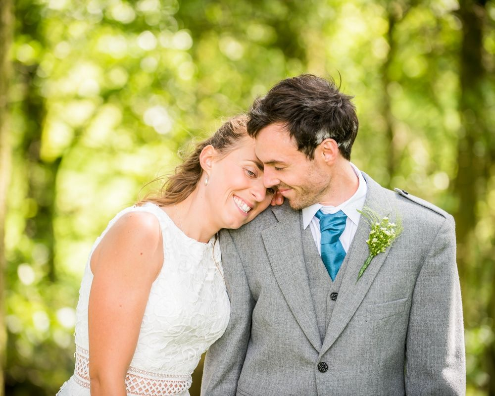 Cuddles in the woodland, Howgills wedding, Sedbergh, Lake District wedding photographers
