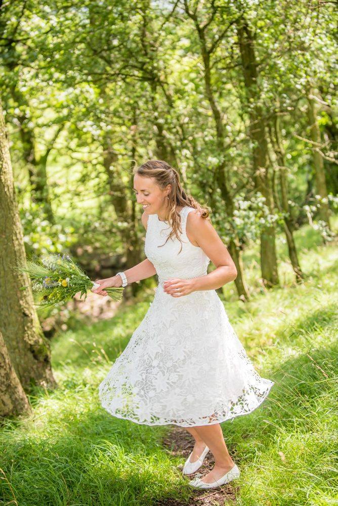 Bec spinning in her dress, Howgills wedding, Sedbergh, Lake District wedding photographers