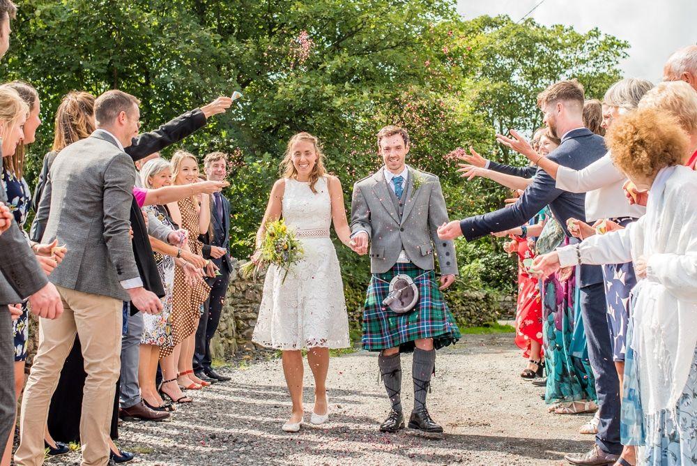 Confetti throwing, Howgills wedding, Sedbergh, Lake District wedding photographers