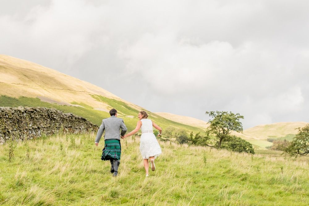 Running through the fields, Howgills wedding, Sedbergh, Lake District wedding photographers