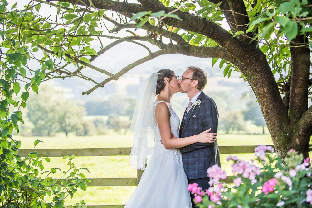 Kissing under tree, Shireburn Arms, Lancashire wedding photographers
