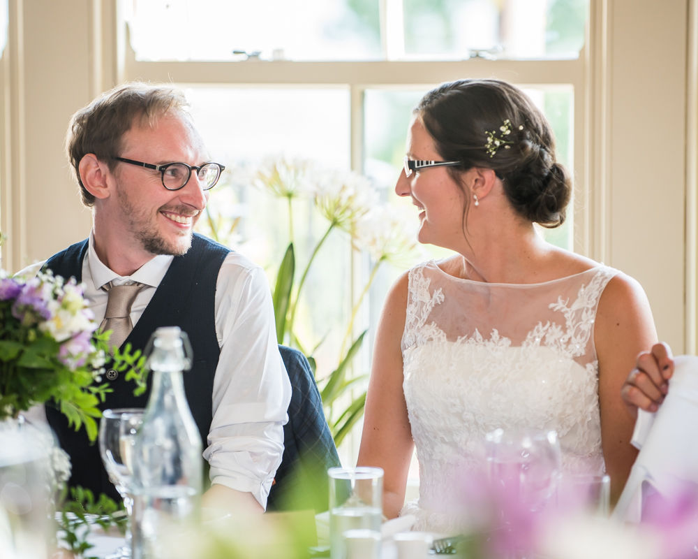 Smiles during the speeches, Shireburn Arms, Lancashire wedding photographers