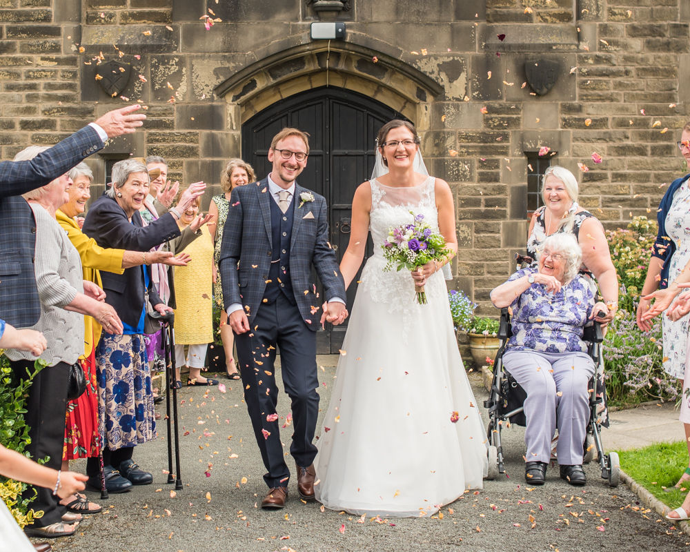 Confetti throwing outside church, Shireburn Arms, Lancashire wedding photographers