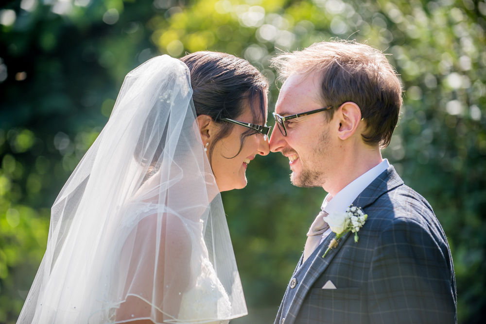 Nose to nose pose, bride and groom, Shireburn Arms, Lancashire wedding photographers