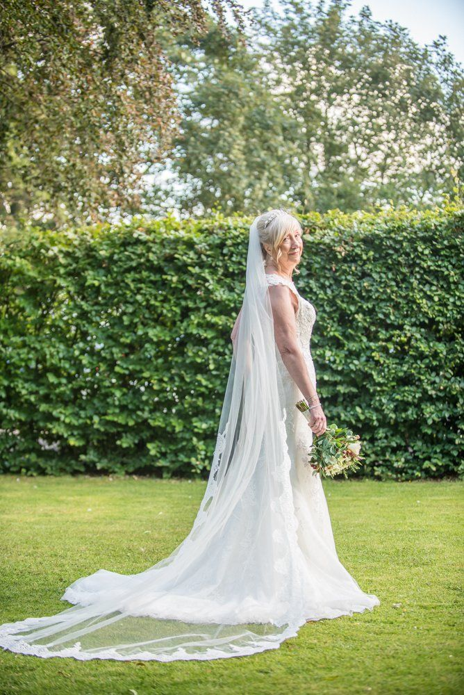Caroline's stunning wedding gown from behind,  Hotel Van Dyk wedding photography Chesterfield