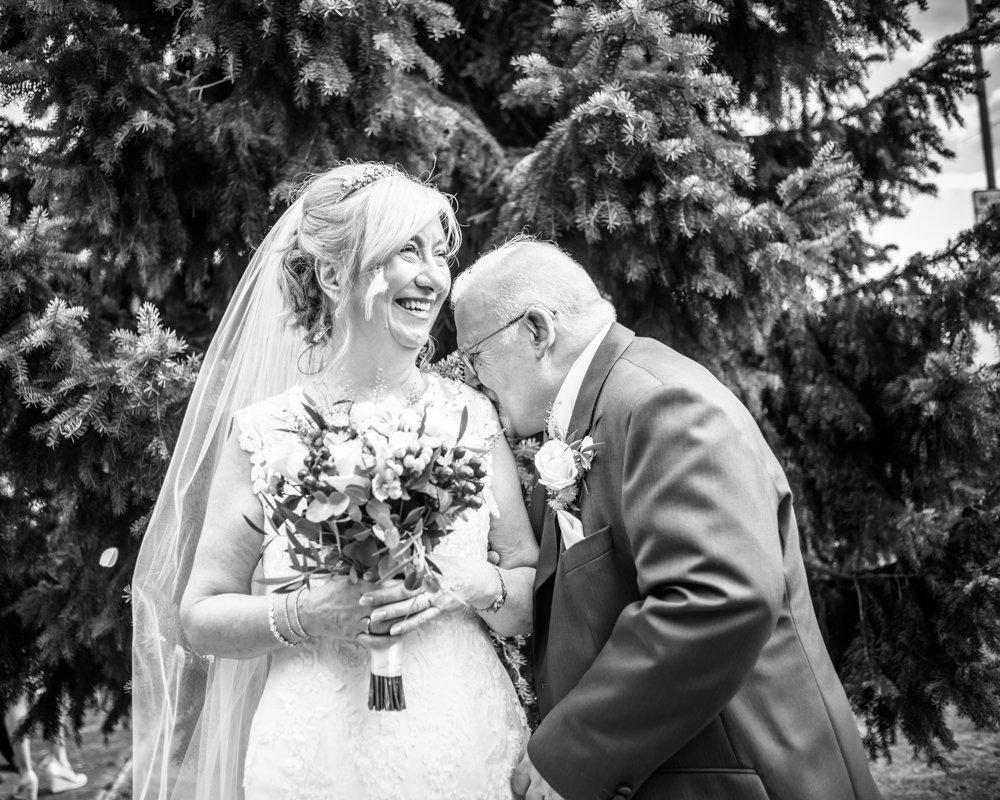 Groom kissing bride's shoulder,  Hotel Van Dyk wedding photography Chesterfield