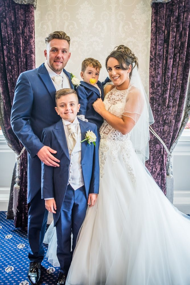 Group photo with their sons, Waterton Park Hotel weddings, Yorkshire wedding photographers