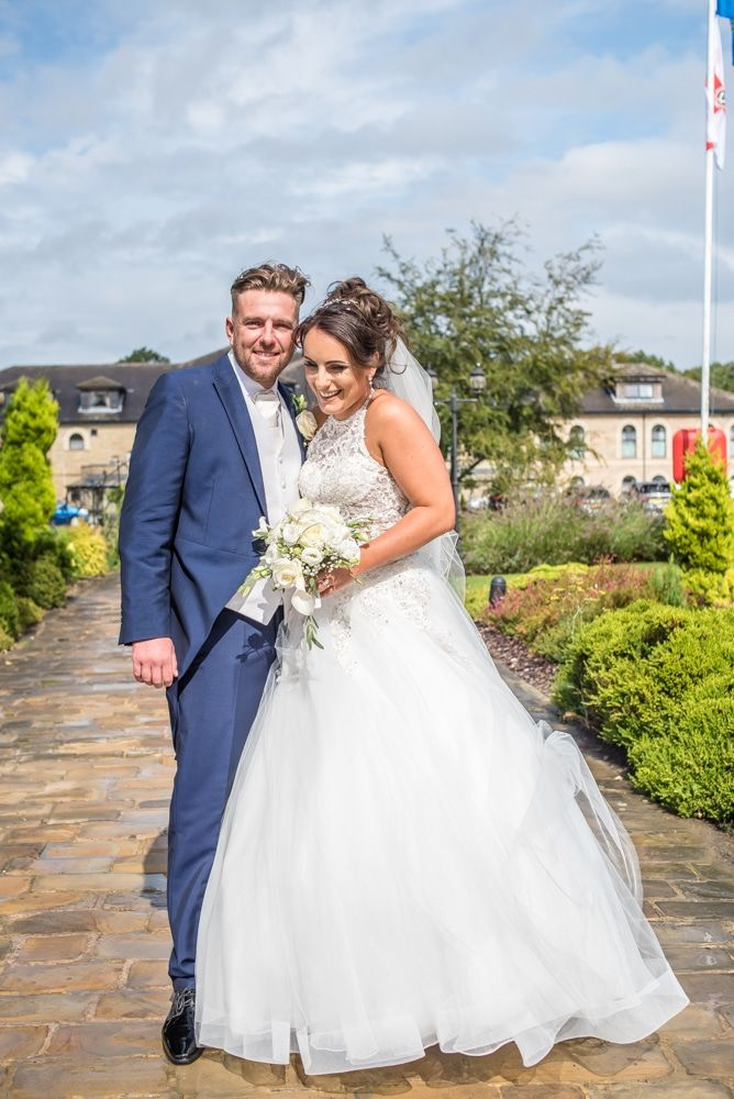 cuddles in the grounds, Waterton Park Hotel weddings, Yorkshire wedding photographers