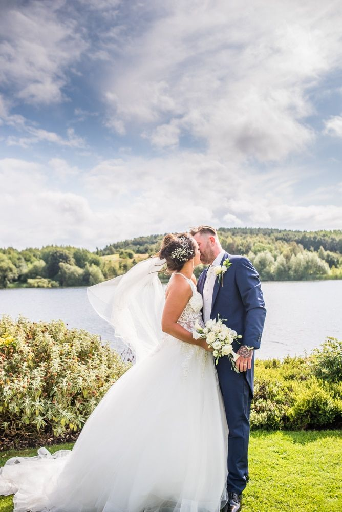 Kisses in the grounds, Waterton Park Hotel weddings, Yorkshire wedding photographers