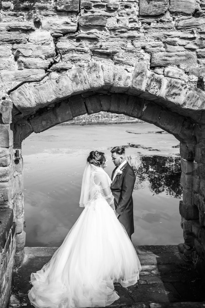 Under the arch by the lake, Waterton Park Hotel weddings, Yorkshire wedding photographers