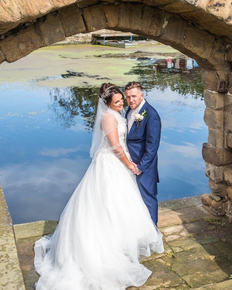 Posing by the lake, Waterton Park Hotel weddings, Yorkshire wedding photographers