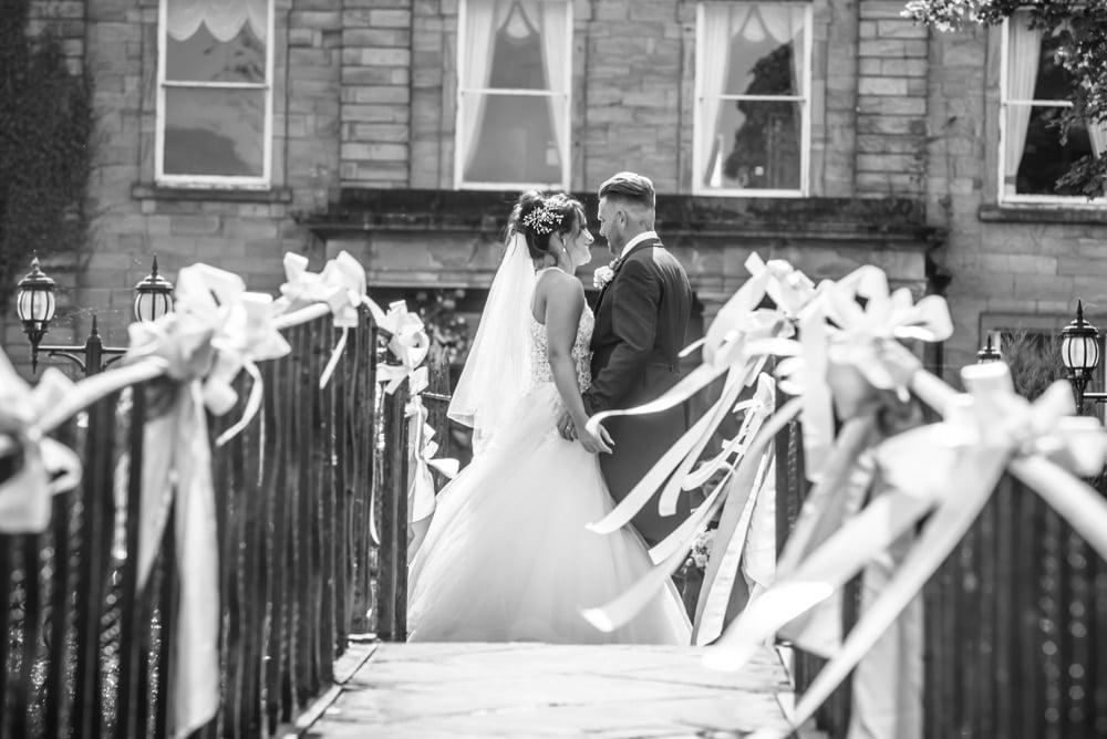 Kisses on the bridge, Waterton Park Hotel weddings, Yorkshire wedding photographers
