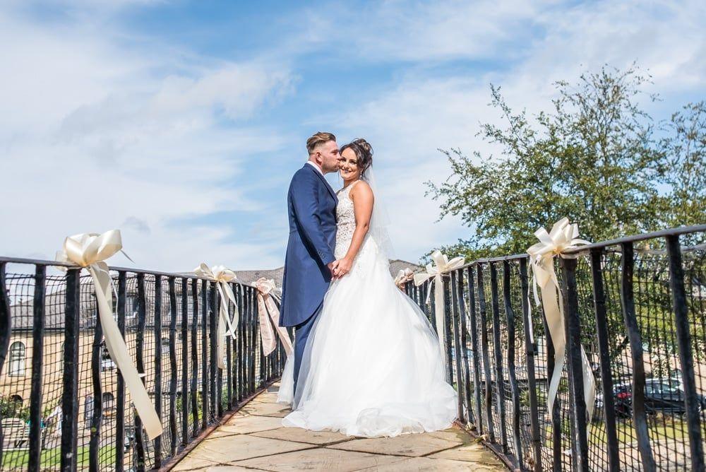 Kiss on top of the bridge, Waterton Park Hotel weddings, Yorkshire wedding photographers