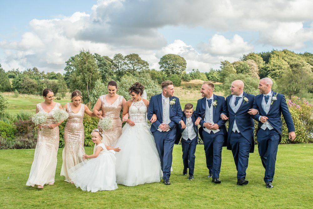 Bridal party walking together, Waterton Park Hotel weddings, Yorkshire wedding photographers
