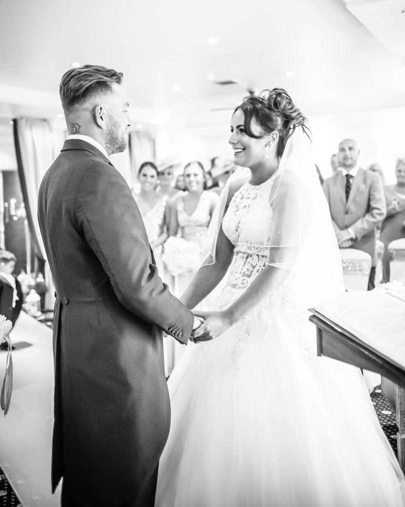 Holding hands in ceremony, Waterton Park Hotel weddings, Yorkshire wedding photographers