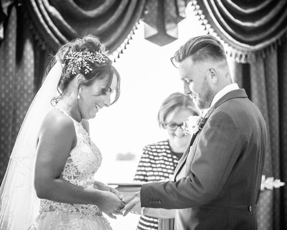 Bride putting ring on groom's finger, Waterton Park Hotel weddings, Yorkshire wedding photographers