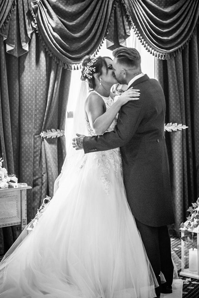 Bride and groom first kiss, Waterton Park Hotel weddings, Yorkshire wedding photographers