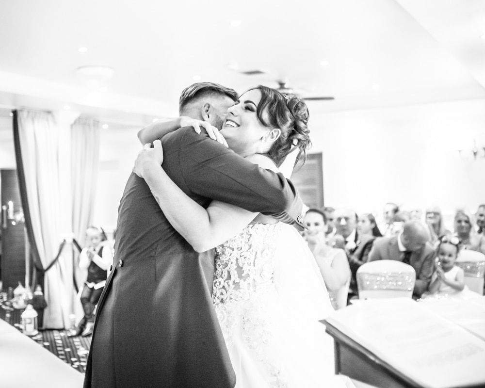 Bride and groom ceremony cuddles, Waterton Park Hotel weddings, Yorkshire wedding photographers