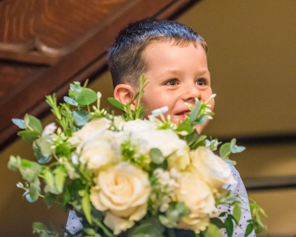 pageboy holding mums bouquet, Lady Gilford's House, Carlisle register office, Cumbria wedding photographers