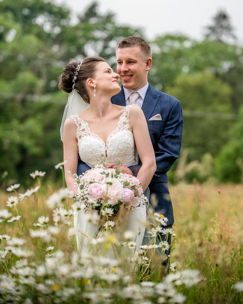 In flower meadow cuddling, Castle Inn, Keswick, Lake District wedding photography