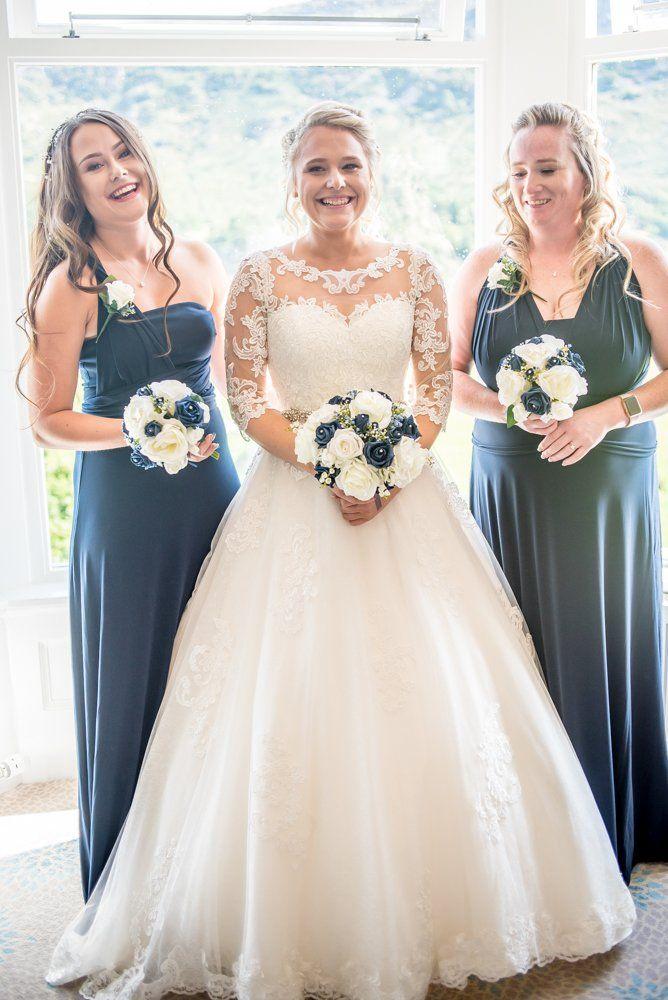 Bride and bridesmaids posing in window, Inn on the Lake Weddings, Lake District