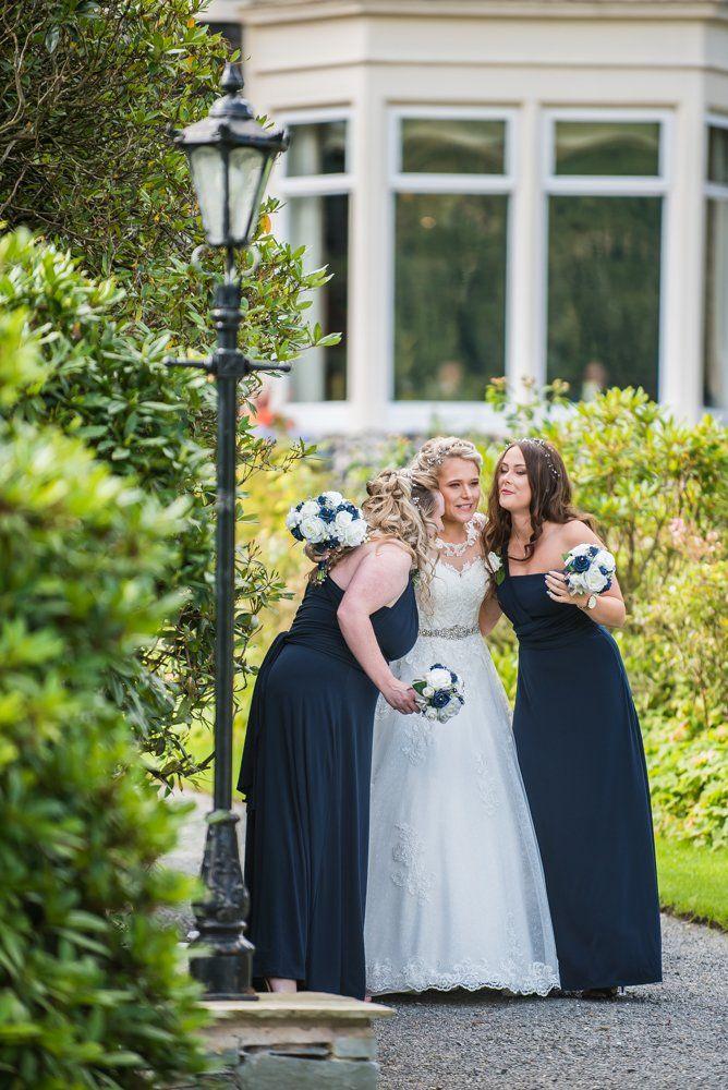 Bridesmaids final hug before walking up aisle, Inn on the Lake Weddings, Lake District