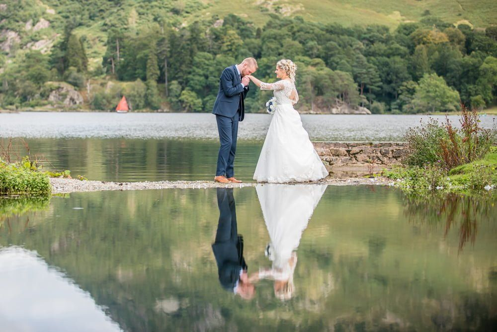 Kissing brides hands, Inn on the Lake Weddings, Lake District