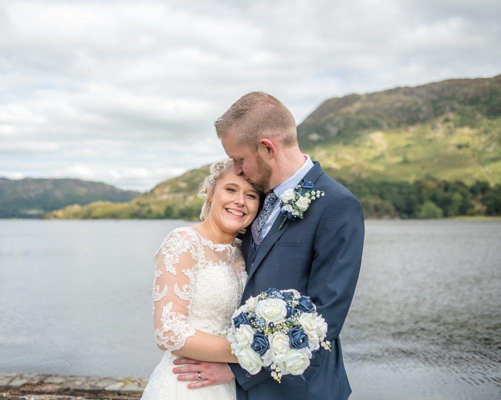 Kisses for bride, Inn on the Lake Weddings, Lake District