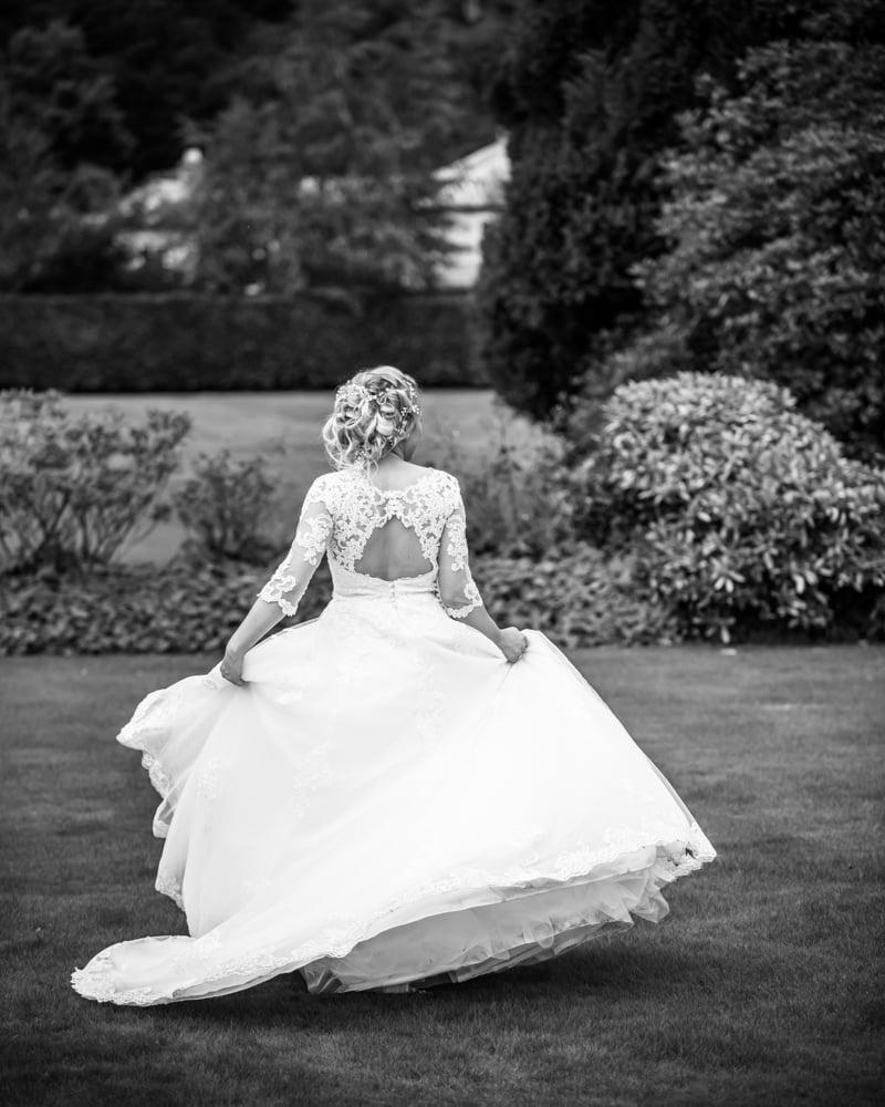 Bride swishing dress around, Inn on the Lake Weddings, Lake District