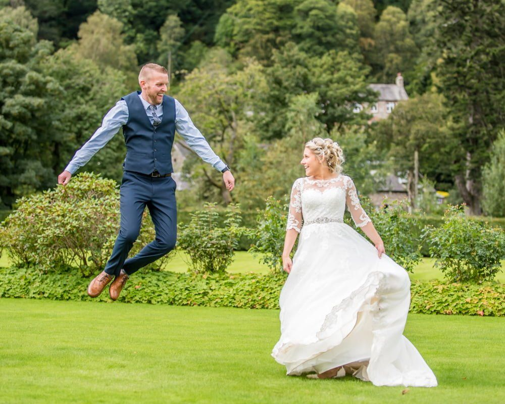 Groom jumping for joy, Inn on the Lake Weddings, Lake District
