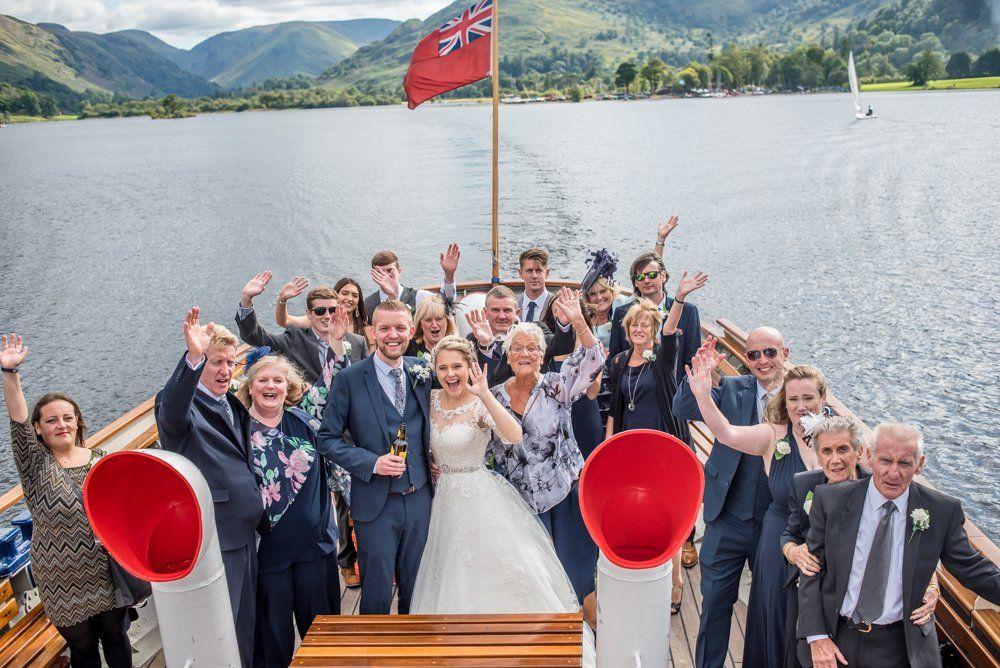 Wedding party waving on steamer, Inn on the Lake Weddings, Lake District