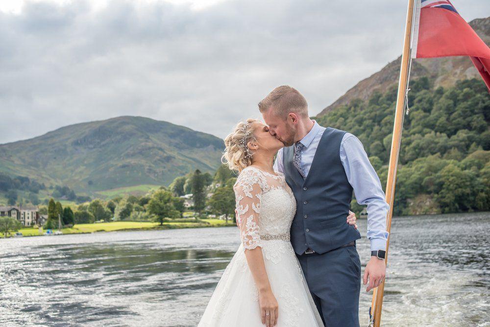 Kisses on the steamer, Inn on the Lake Weddings, Lake District