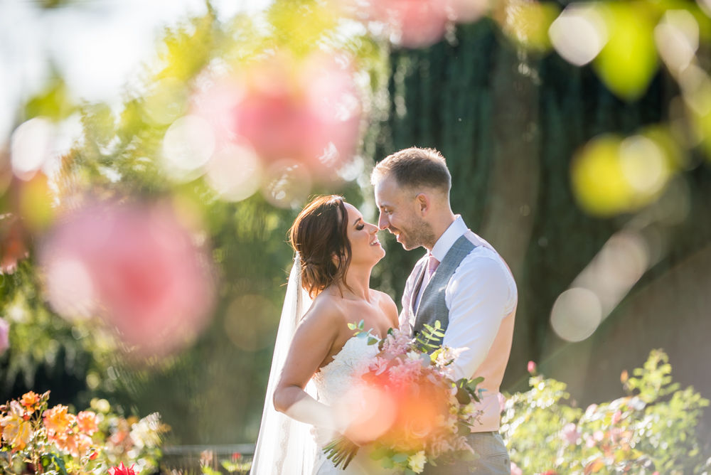 Bride and groom kisses in rose garden, Ringwood Hall weddings, Sheffield photographers