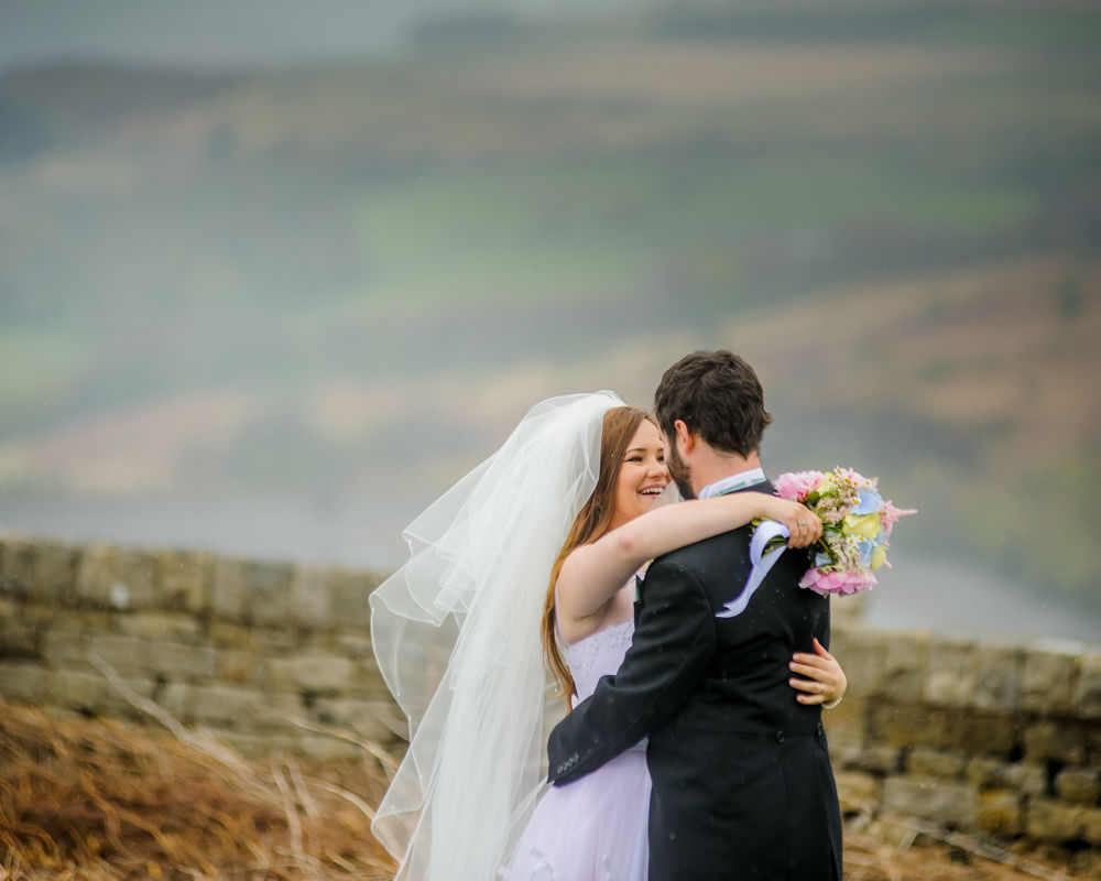 Bride and groom in rain in moors, cheap lake district wedding photographers