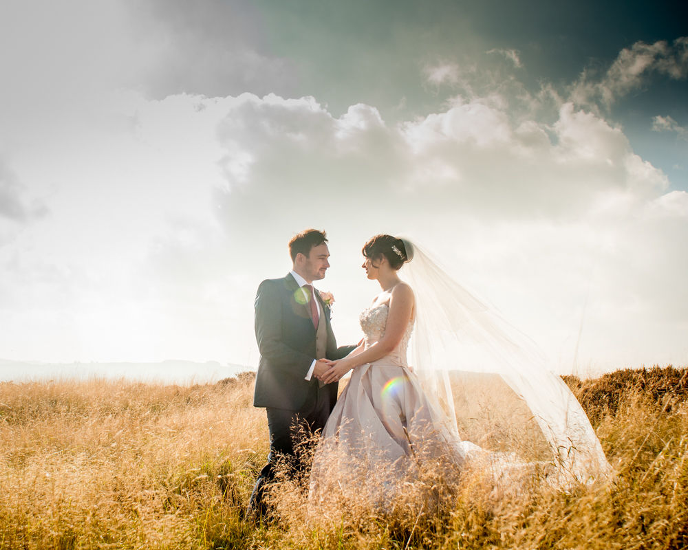 Bride and groom in sunshine, Peak District, female wedding photographer, Sheffield weddings
