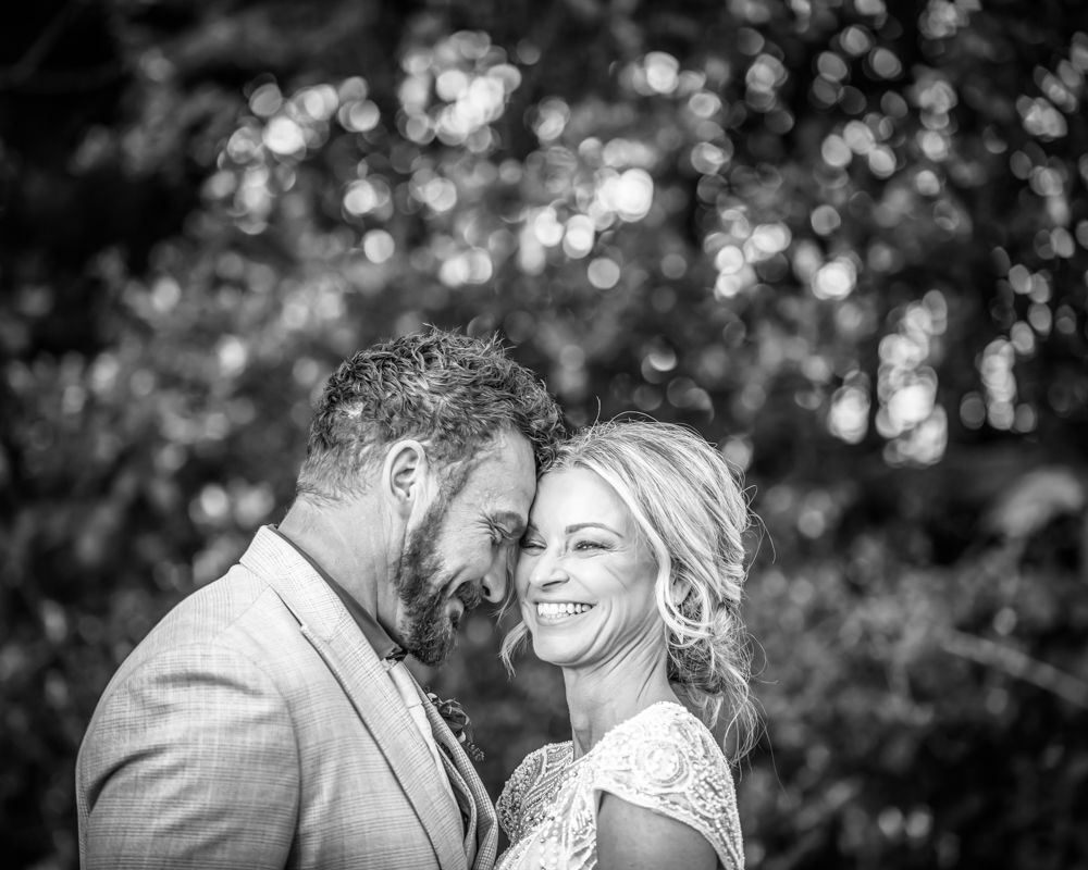 Bride and groom laughing, Sheffield natural wedding photography