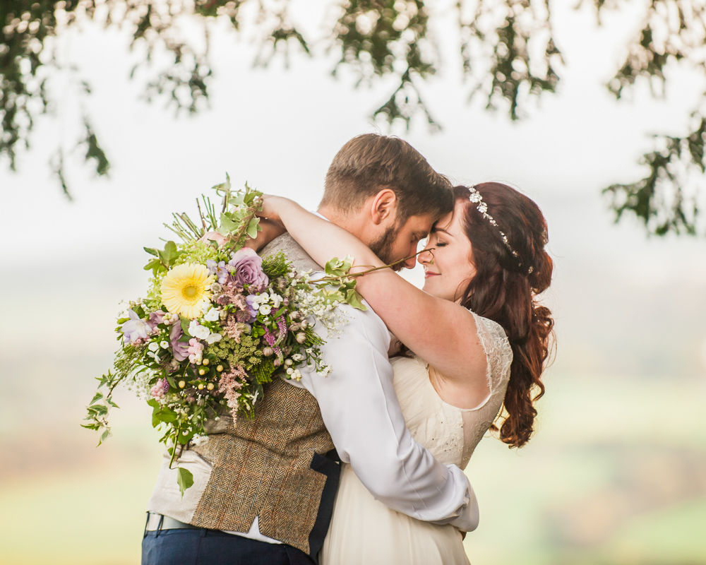 Bride and groom looking at each other, Gretna Blacksmiths Shop wedding photography