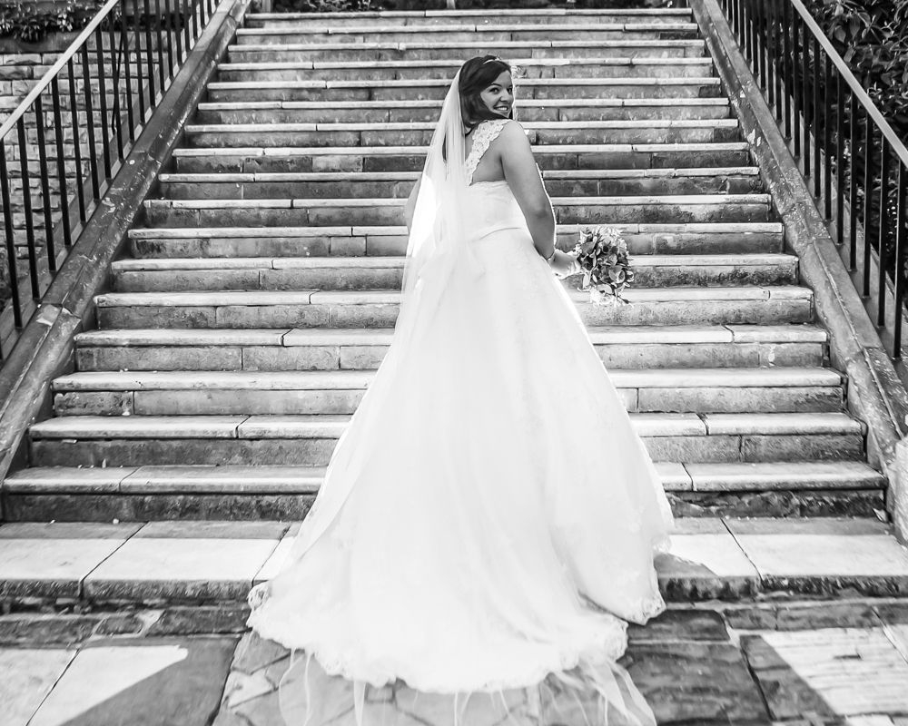 Bride posing on stairs, cheap lake district wedding photographers
