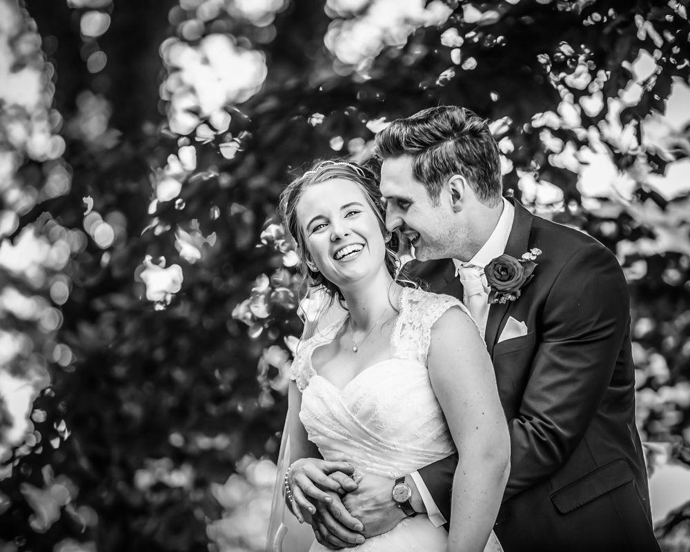 Cuddles in venue grounds, alternative wedding photographers Sheffield