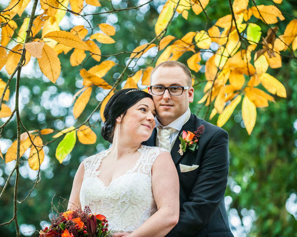 Cuddles under Autumn leaves, Natural  wedding photography in Sheffield