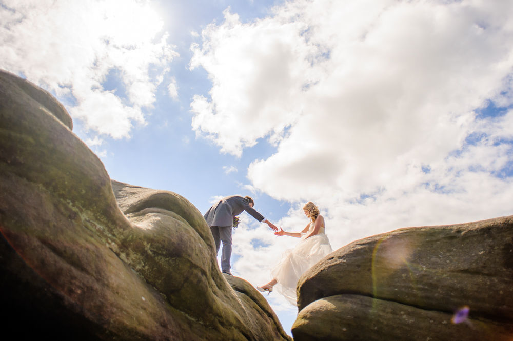 Emma & Nick holding hands on rocks, Surprise View, Peak District wedding photographers Sheffield