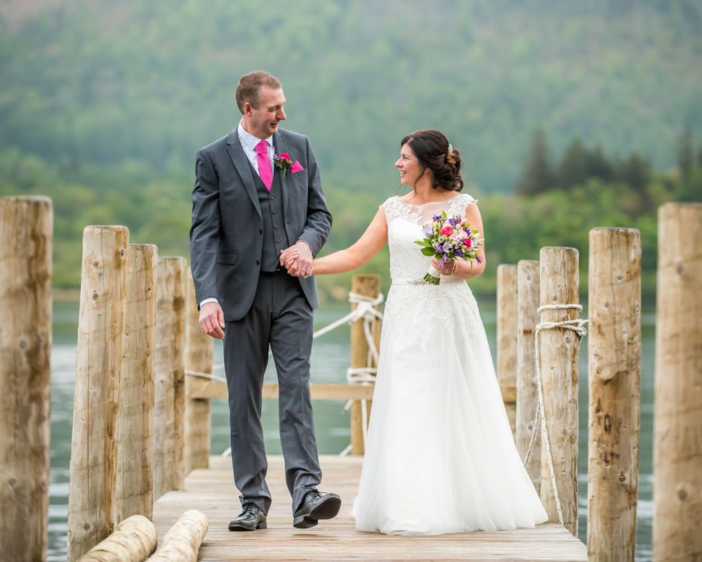 Gill and Monty walking on jetty at Lingholm Estate, Lake District wedding photographers