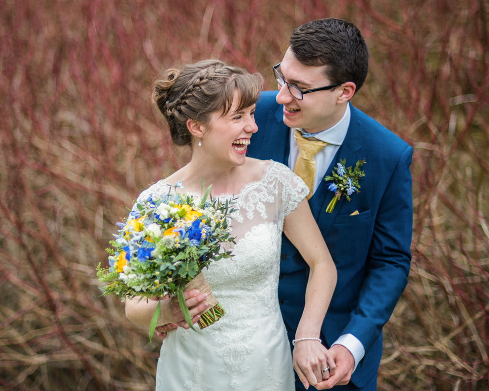 Laughing bride and groom, Whirlowbrook Hall, alternative wedding photographers Sheffield