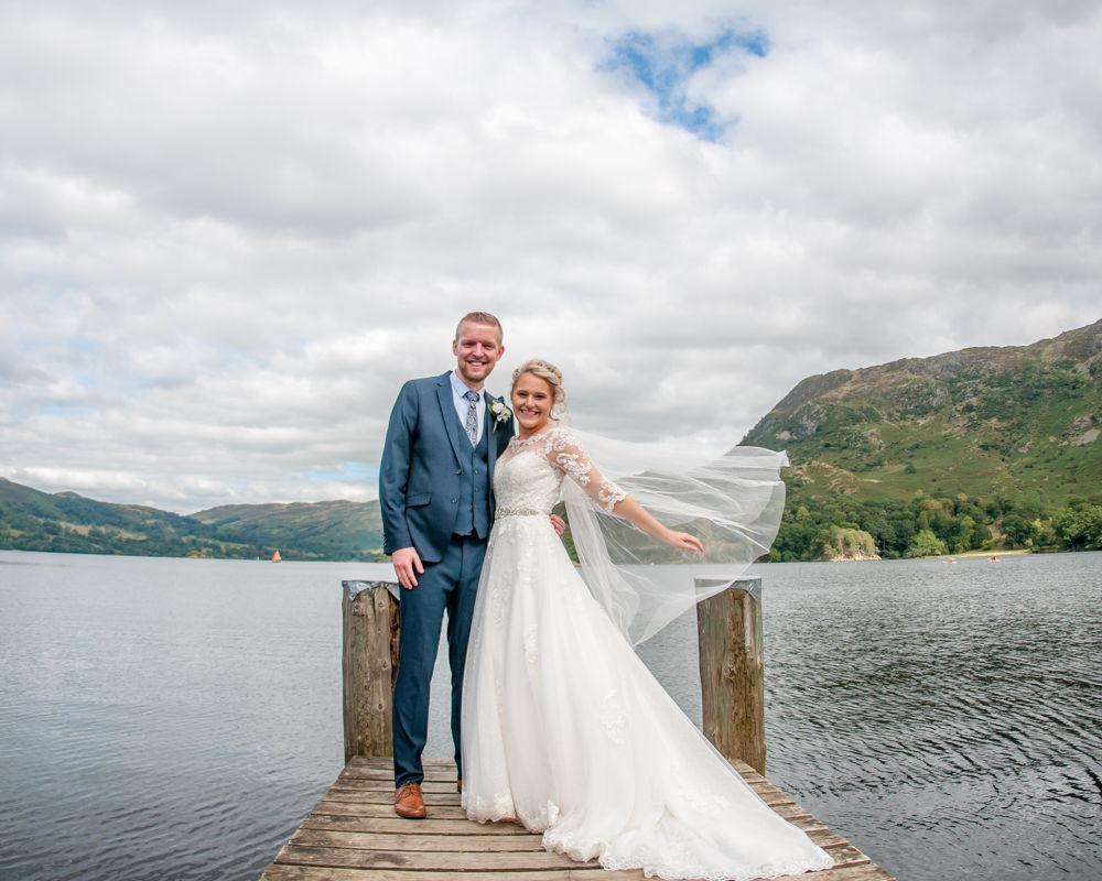 Sarah and Joshua on jetty at Inn on the Lake, Lake District wedding photography