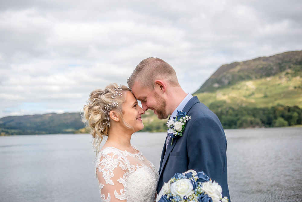 Sarah and Joshua touching heads Windermere wedding photographers, Lake District elopement
