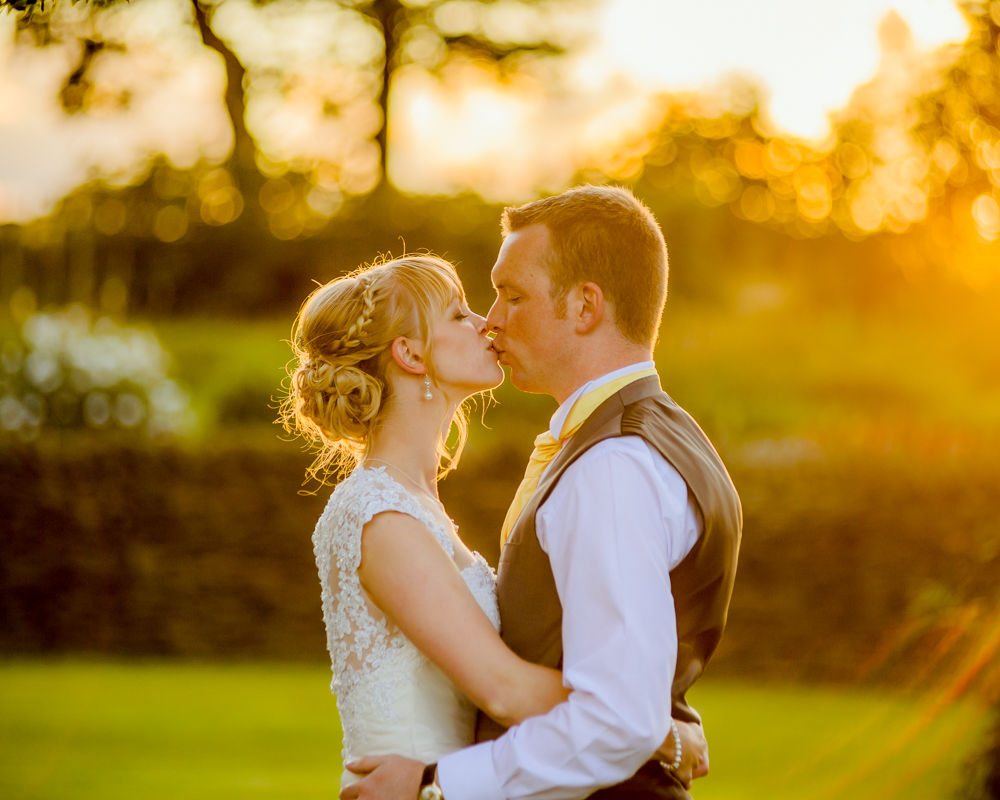 Verity and Adam kissing at sunset, Smallshaw Farm Cottages weddings, Sheffield wedding photography