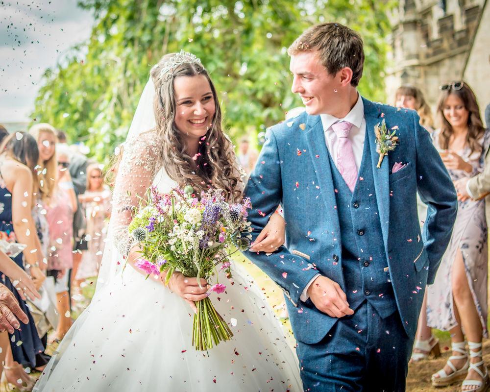 Walking through confetti, Lake District alternative wedding photographers
