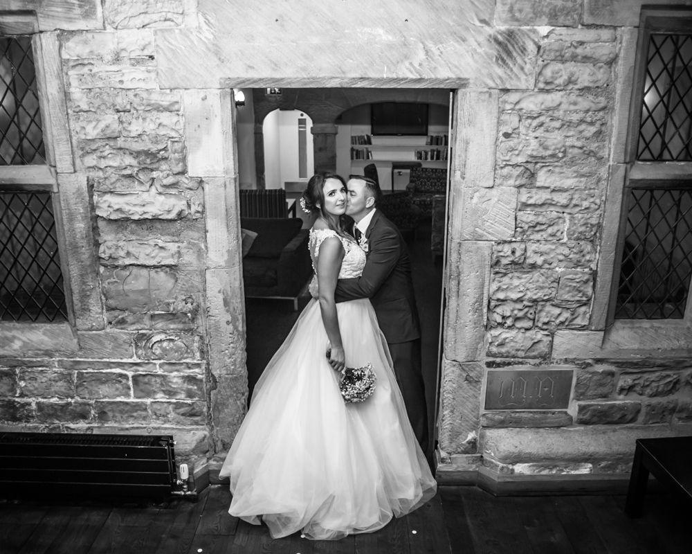 Bride and groom posing in Mosborough Hall