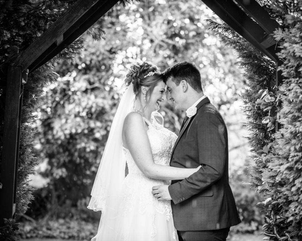 Bride and groom touching heads laughing, Mercure Dunkenhalgh wedding