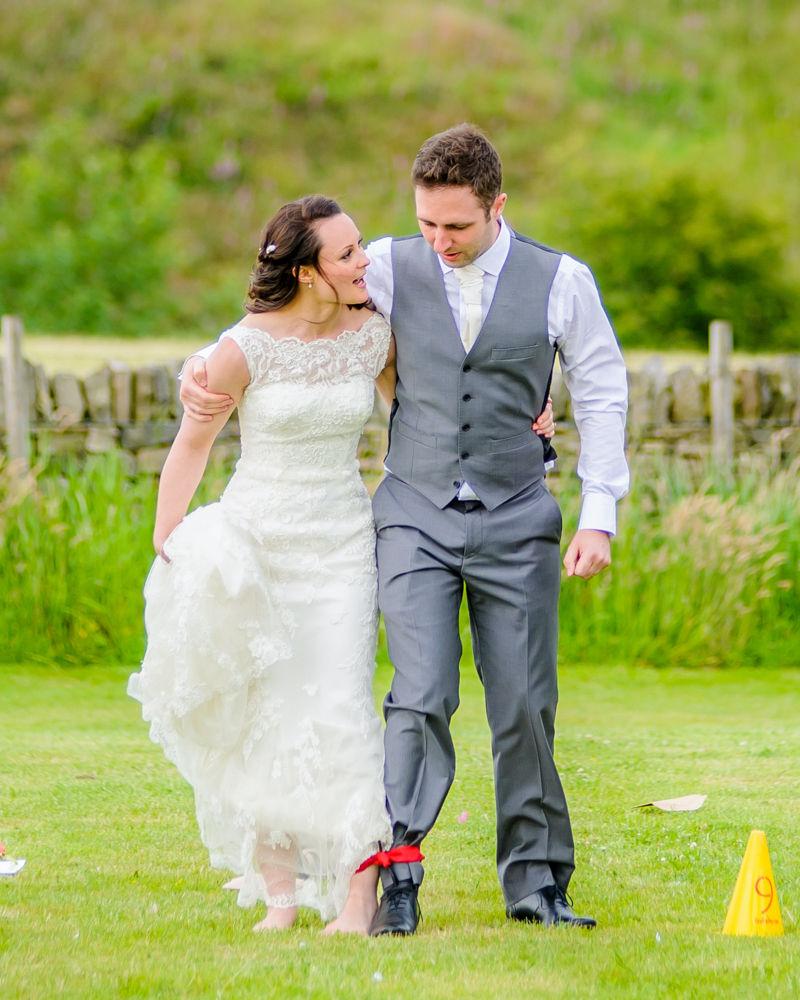 Bride and groom in three legged race